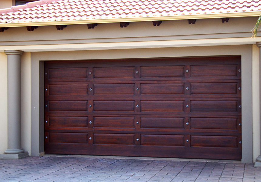 Wooden garage doors pretoria wide range wood doors for Rustic wood garage doors